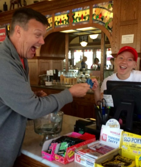 South Pier Parlor Employee Junior Madisyn Riste accepts Teacher Mr. Jon Schrank's debit card as he pays for his delicious ice cream. The choice must have been difficult since the ice cream shop offers over 30 flavors!