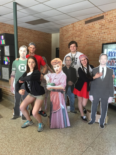 Classic Characters--This year's MC's, Seniors Erin Gamb, Philip DeTrana,  Silas Brunn, and Amanda Hoffmann  pose with famous TV characters. The set up for the show often takes several hours starting the Friday afternoon before the show.