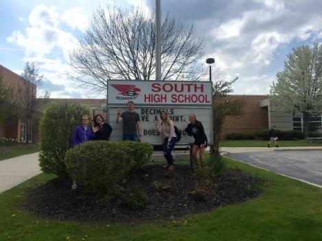Seniors Paige Bohlman, Pachia Yang, Peter Reinke, Sydnee Pribbernow, and Jordan Lohse pose in front of their high school symbolizing a goodbye to the facility they've spent four years making memories in the activities they love.